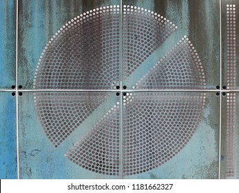 blue painted industrial rusty metal plates with round perforated circular pattern