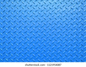 blue painted industrial steel sheeting with grid textured flooring pattern