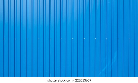 blue painted iron fence of corrugated long with screws