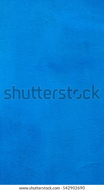 Blue painted plaster wall texture useful as a background - vertical