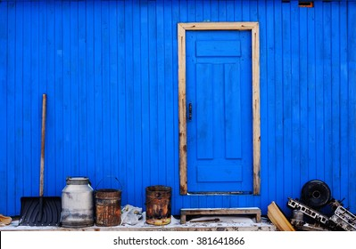 Blue painted traditional house in russian village