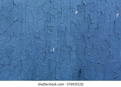 Blue Painted Wall with Cracked Grungy Surface on Exterior Building in London
