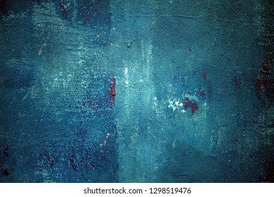 blue painted wall texture with a red paint drip