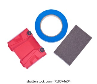 Blue painter's tape, jumbo sanding sponge and paint trimline edger isolated on white background