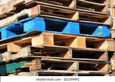 Blue pallet among stack of pallets
