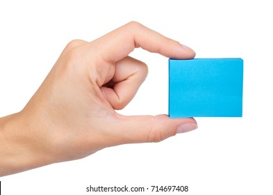 Blue paper note pad in hand isolated on white background