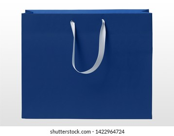 blue paper shopping bag over clear white background