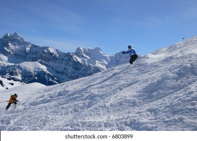 Blue parka skier,with Dents du Midi in background,Mosettes - Cubere area,Chatel,French Alps,France