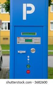 a blue parking ticket automat on street