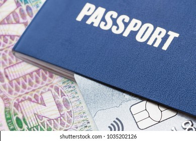 Blue passport with platinum credit card on the schengen visa background. Closeup, selective focus, toned