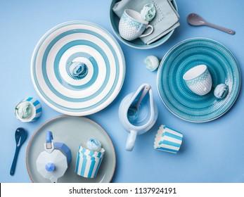 Blue pastel ceramic tableware crockery set on abstract background