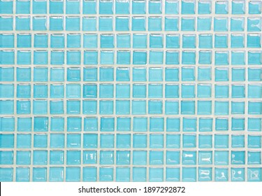 Blue pastel ceramic wall and floor tiles abstract background. Design geometric mosaic texture decoration of the bedroom. Simple seamless pattern for backdrop advertising banner poster or web.