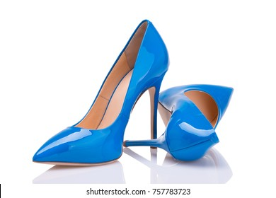 Blue patent leather shoes on a white background