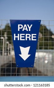 Blue Payment Sign in Urban Setting
