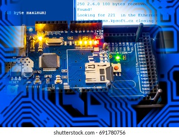 Blue PCB with microcontroller and communication module.22