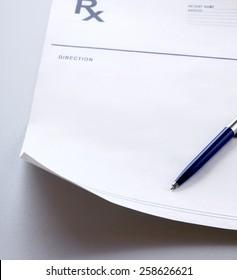 A blue pen on a rx prescription.