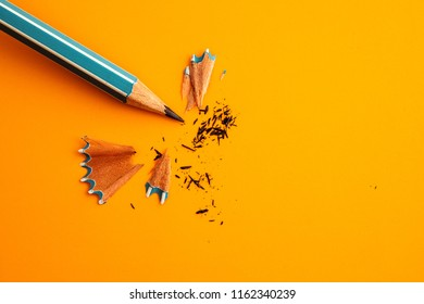 blue pencil on yellow orange background ,creative innovation idea symbol concept