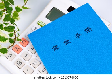 """Blue pension book. Translation on book text:""""pension book"""". Translation on calculator text: """"Tax rate""""."""