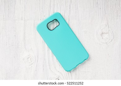 Blue phone case on rustic wooden background and space for text