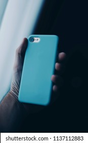 Blue phone in hand
