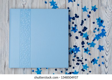 blue photo book with  leather cover.  stylish wedding photo album.  Beautiful photobook on a wooden background.