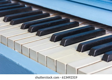 Blue piano close-up with black and white keys