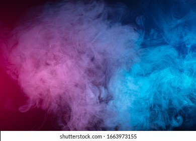 Blue and pink bomb smoke on black isolated  background