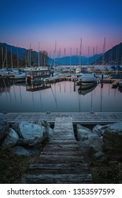 Blue and pink colored sunset in port of Ascona, Switzerland