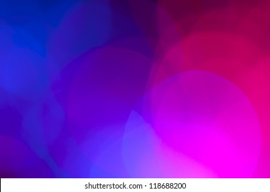 Blue and pink festive lights and circles background. Christmass lights