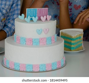 a Blue and pink fondant cake for Gender reveal party