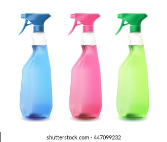 Blue, pink and green spray bottles on white.