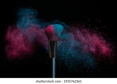 Blue and pink makeup on a powder brush hit in a mixed cloud