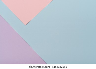 Blue and pink pastel color paper geometric flat lay background