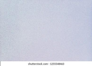 blue pink pearl glitter paper background, close up. Gradient glitter background from wrapping paper.