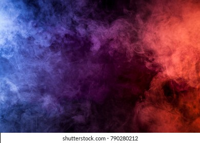 Blue, pink, purple vape smoke on black isolated background