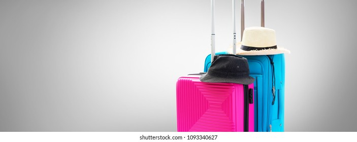 Blue and Pink Trunks Two Suitcases Luggage Travel Things Accessories Clothes Summer Hats Concept Holiday Adventure Trip Isolated on Grey Background Banner