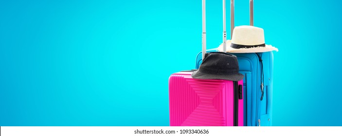 Blue and Pink Trunks Two Suitcases Luggage Travel Things Accessories Clothes Summer Hats Concept Holiday Adventure Trip Isolated on Blue Background