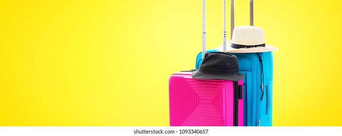 Blue and Pink Trunks Two Suitcases Luggage Travel Things Accessories Clothes Summer Hats Concept Holiday Adventure Trip Isolated on Yellow Background