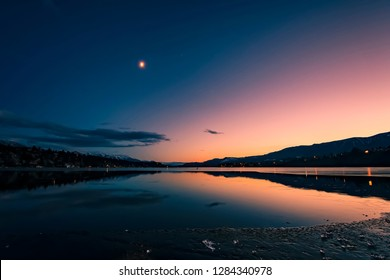 Blue, pink, and yellow sky on the shores of James Chabot Provincial Park, Invermere, British Columbia, Canada