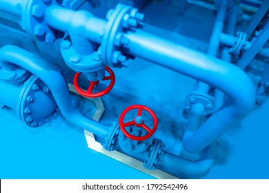 Blue pipes with red valves. Fuel industry. Industrial equipment. Fuel production. Pipes with valves for gas supply. Gas distribution system. Liquefied natural gas.