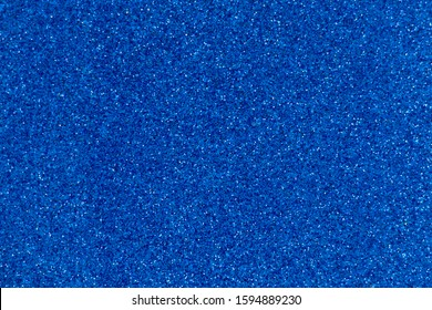 Blue plain background with granular shine. Bright glitter.