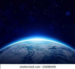 Blue Planet Earth sunrise over cloudy ocean with stars in the sky, An eclipse of the Sun by the world make rising sun in space can use for background - Elements of this image furnished by NASA