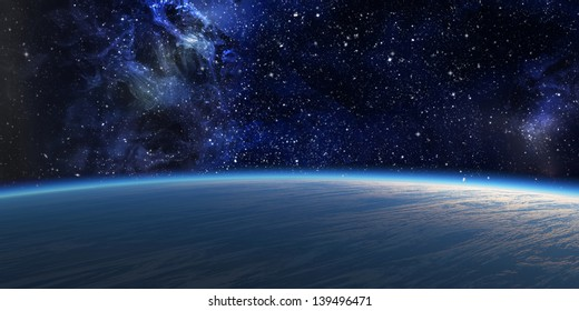 Blue planet with nebula on background.
