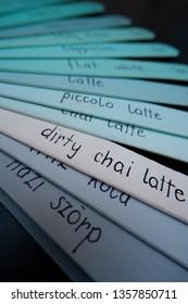 blue planks menu with various coffee names