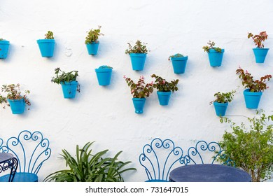 Blue plant pots in the small streets of Mijas (Andalusia, Spain)