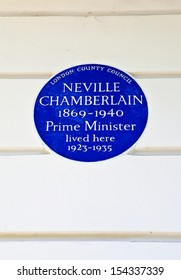Blue plaque marking the former residence of Neville Chamberlain - a former Prime Minister.