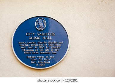 Blue plaque on wall outside Leeds city varieties, Leeds, West Yorkshire, UK