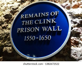 Blue Plaque signage of the remains of the clink prison wall, London, UK, 2019.  The prison is in Southwark, and was a notorious  prison, part of the original wall still stands.