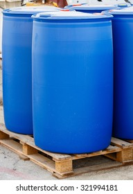 Blue plastic barrels on pallet in a chemical plant