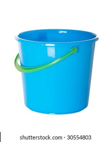 Blue plastic beach pail with green handle